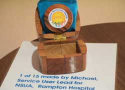 One of the special hand made presentation boxes, the work of a service user from Rampton Hospital